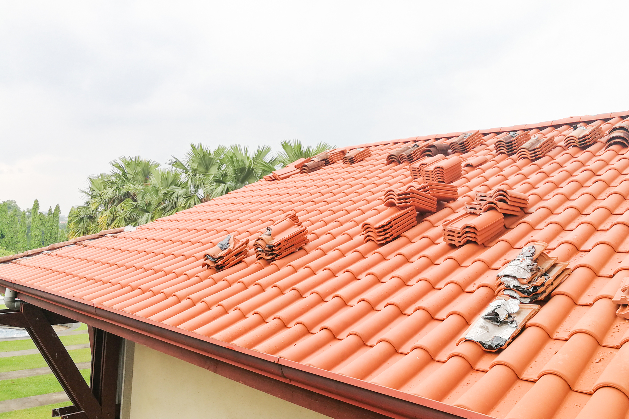 Old tile roofing material being replaced