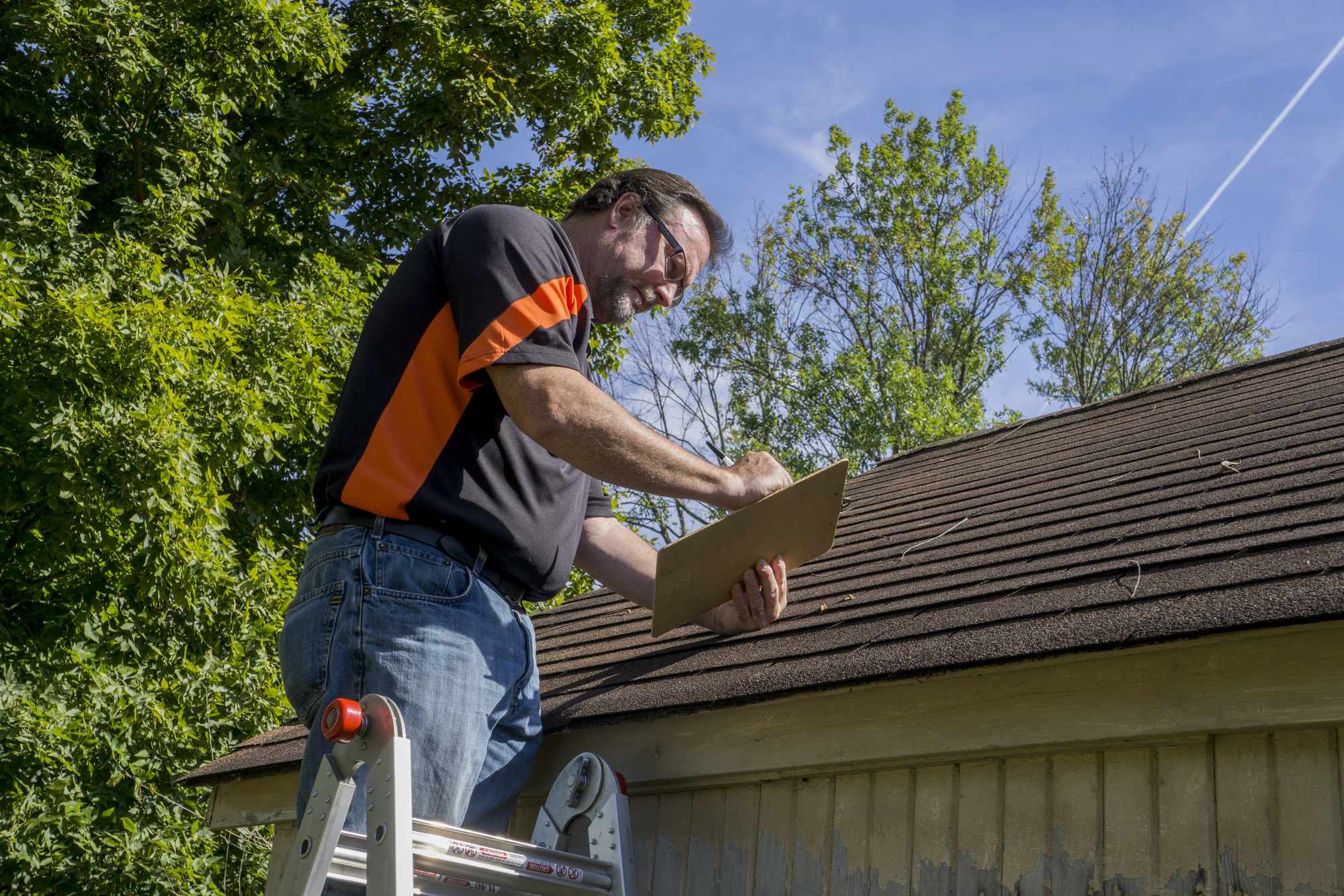 Man laying new roof