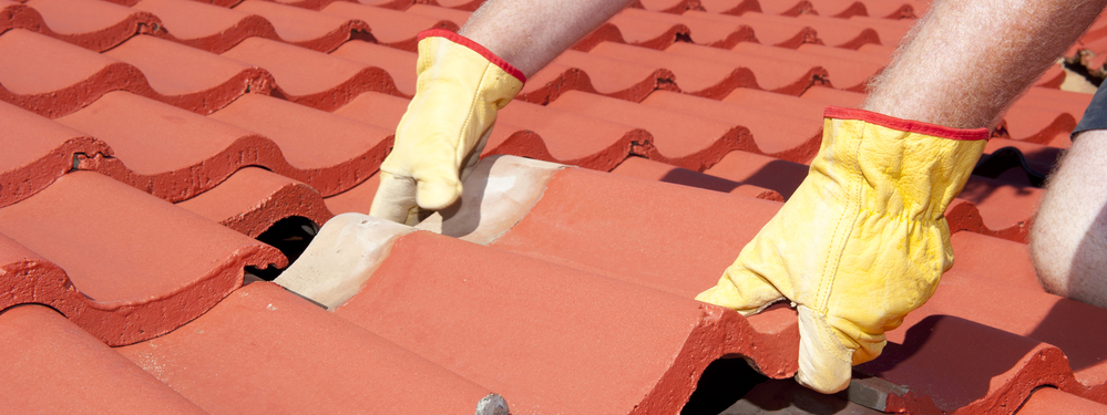 Contractor installing tile roof